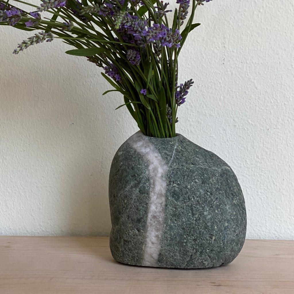 stone vase holding lavendar